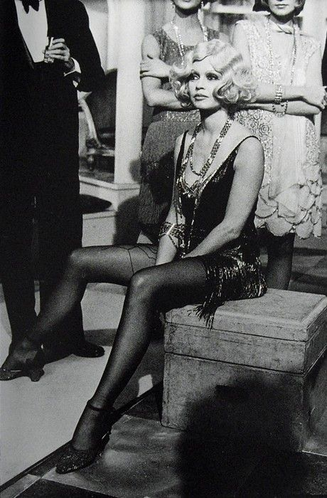 Brigitte Bardot --- one of the characters passing by on the street in the short story Under the Third Story Window resembles Brigitte Bardot . . .