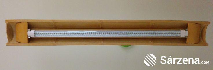 Media caña de bambú para iluminar el pasillo.