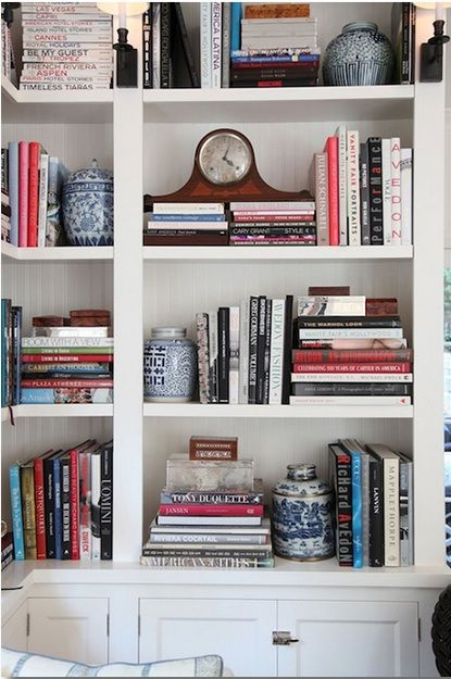 bookshelf style: little cluttered but likely amount of book:stuff ratio