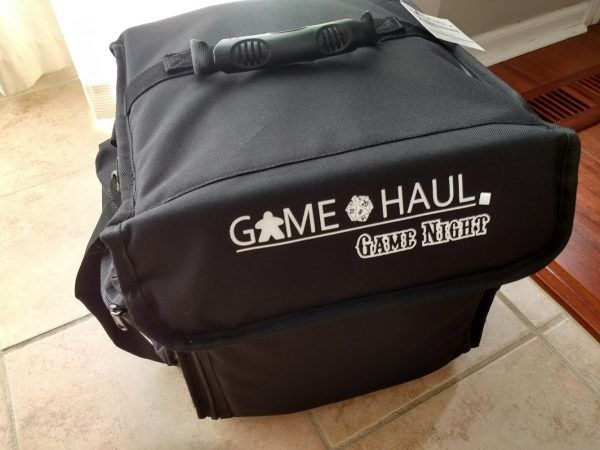 BGS Reviews: Game Haul: Game Night Board Game Bag  Item: Game Haul: Game Night Board Game BagManufacturer: Top Shelf FunBGS Rating:   Like most people I attend a weekly game night and usually tote my games around in one of the blue Ikea bags. Its spacious and gets the job done but it doesnt offer a lot of protection. After recently seeing that I dished in the cover of Terraforming Mars sometime during the night I decided to pursue a better option. The re-purposed cajon/ChromaCast bags are…