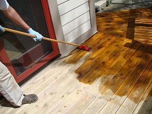 how to stain and seal a wood deck--pictures of process and discusses tools needed