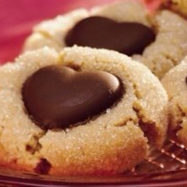Peanut Butter Heart Cookies    1 egg  1 cup sugar  1 cup Pnut butter    Stir together, make small balls, roll in sugar, place on greased cookie  Sheet and flatten with sugar coated bottom of small glass.  Bake at 350 for 7-9 minutes    Place small Dove chocolate heart on top of each cookie.