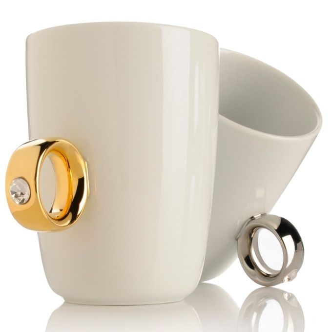 "2-Carat Coffee Cup by MoMA Design Store. I was gifted what I call my ""bling cup"" a couple of years ago, and it's still my favorite coffee cup. I love how it looks like I'm sporting a giant diamond ring while sipping my coffee. It's the best way to feel fabulous in the morning."