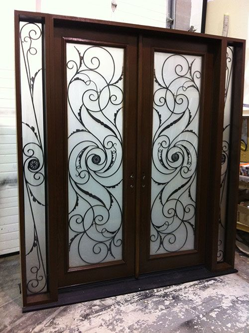 Image from http://windowsanddoorstoronto.ca/wp-content/uploads/2014/07/Wrought-Iron-Serafina-Design-Double-Doors-with-2-Iron-Art-Side-Lites-Installed-by-Windows-and-Doors-Toronto.jpg.