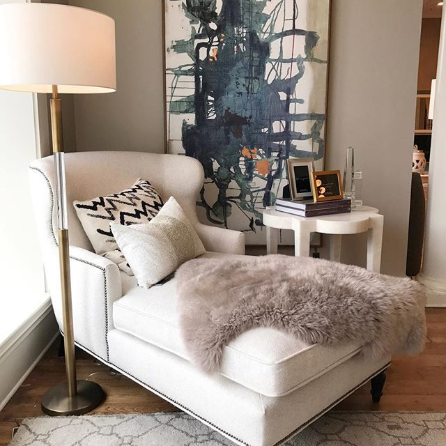 This cozy corner hangout is calling your name. A lilac fur throw? This is what interior design dreams are made of.