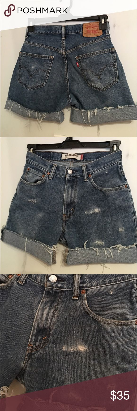 Distrssed Levi's SALE These are cut off and distressed by me   They are size 29 waist and are ready for those summer concerts or just hanging out! 6 in length unrolled Levi's Shorts Jean Shorts