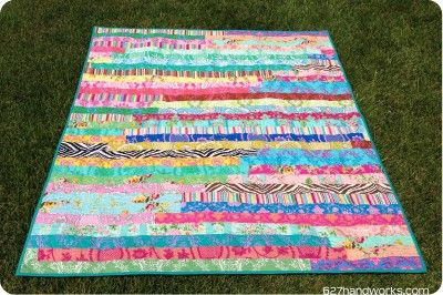 Jelly Roll Race Quilt - This jelly roll quilt pattern couldn't be quicker! With strip quilt piecing and any nearby fabric, you can finish this quilt from @Julie Hirt fast.