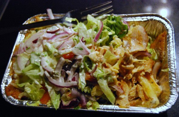 The Kapsalon is a populair Dutch fastfood dish. It literally means 'Barbershop' and consists out of french fries, kebab, garlic and sambal sauce, melted cheese and salad. It's called a Kapsalon because it was regularly ordered by a barbershop in Rotterdam.