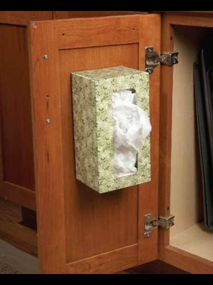 Thumbtack to hold box for plastic bags.