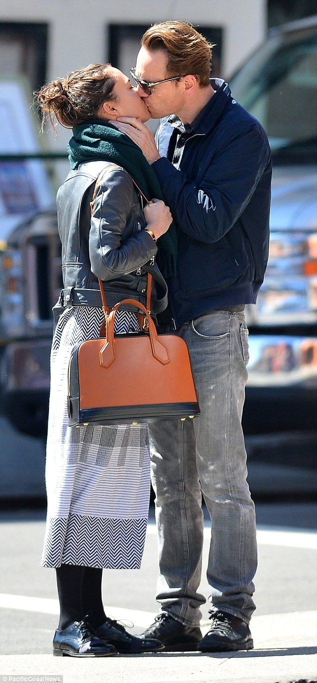 Kiss me quick: Michael Fassbender and Alicia Vikander couldn't help sharing a passionate smooch as they strolled around New York on Saturday
