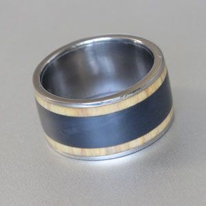 titanium with black teflon and wild olive wood ring