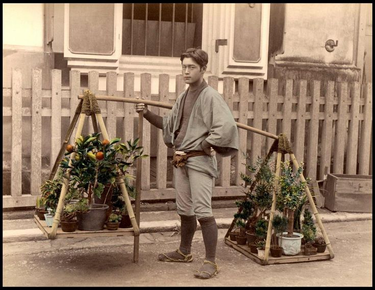 The itinerant tree seller posing at the quite unusual house... And he looks more European than usually Japanese do in that time