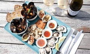 A Bangor Wine and Oyster Shed seafood platter featuring fresh local produce and wine.