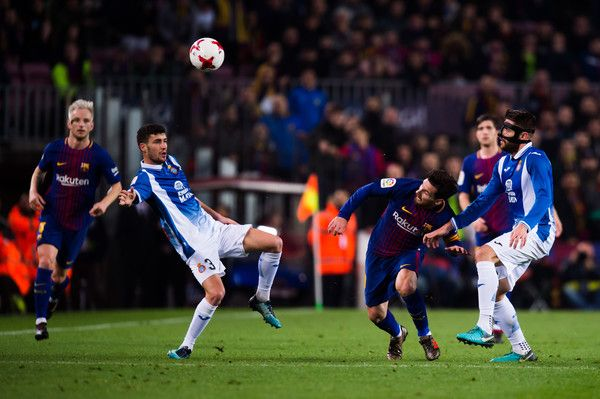 Lionel Messi of FC Barcelona competes for the ball between Aaron Martin and David Lopez of RCD Espanyol during the Spanish Copa del Rey Quarter Final Second Leg match between FC Barcelona and RCD Espanyol at Camp Nou stadium at Camp Nou on January 25, 2018 in Barcelona.