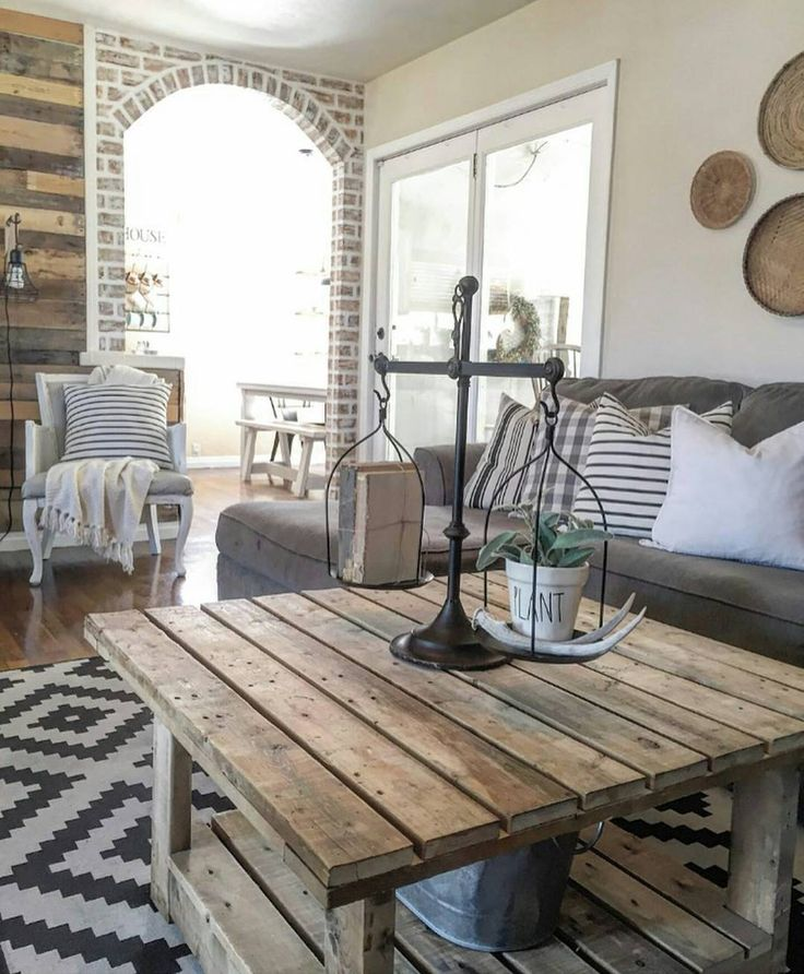 Beautiful space. Love the pallet coffee table, exposed brick, rug, etc...
