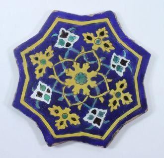 A Safavid Cuerda Seca Glazed Pottery Star Tile, Iran or Central Asia, 16th/17th century - Indian & Islamic 27 september - 6 October 2011 - Auction Atrium