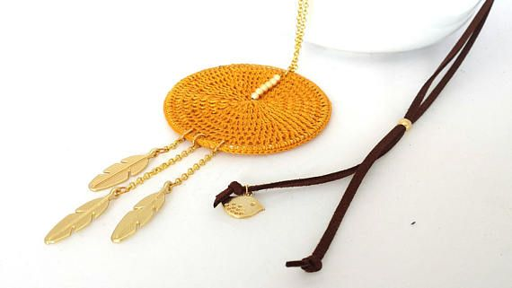 Check out this item in my Etsy shop https://www.etsy.com/listing/522639669/ocher-long-necklace-with-pendant-ethinic