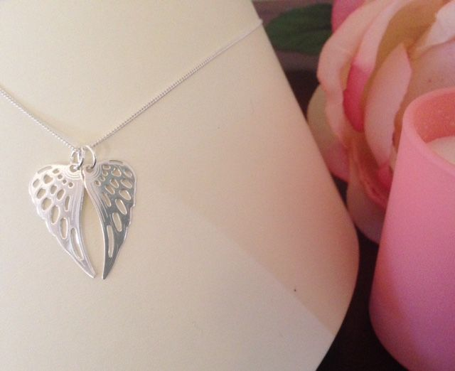 Angel wings. Meaningful sterling silver pendants. Versatile to wear.  Share with a loved one. Mother and daughter. Best friends. Aunty and niece. Sisters.