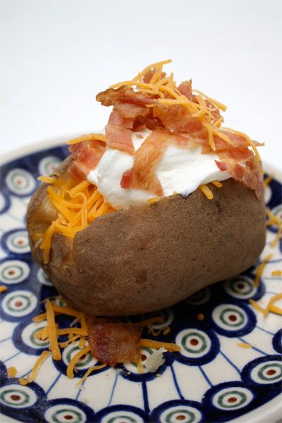 Crock Pot Baked Potatoes -     Wash and dry potatoes.    Cover each potato in aluminum foil and place in a crock-pot.    Cook on low for about eight hours.    Load them up with your favorite toppings, serve with a big salad and dinner is served!