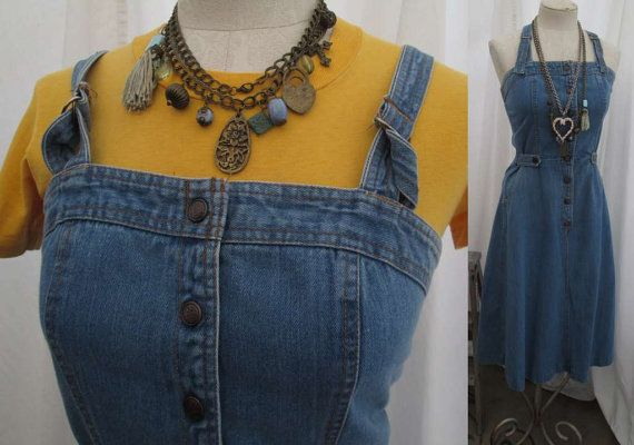 So groovy, vintage 70s denim overalls dress has suspender straps, lots of orange stitching and seams and lots of natural wear and fade. The straps