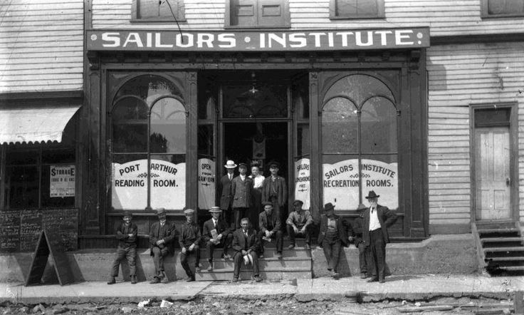 https://flic.kr/p/t3LNKN | Port Arthur's Sailors Institute | Date: c. 1910/1911 Description: This photograph shows an exterior view of the Port Arthur's Sailors Institute with either patrons or employees (primarily men) grouped in front. The Institute provided railway and shipping employees with temporary lodging, as well as games and reading rooms to keep them entertained while they were in Thunder Bay. As the city rapidly expanded, the PA Sailor's Institute's original building proved in...