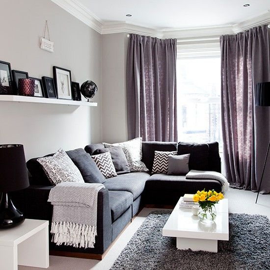 Grey traditional living room with purple soft furnishings