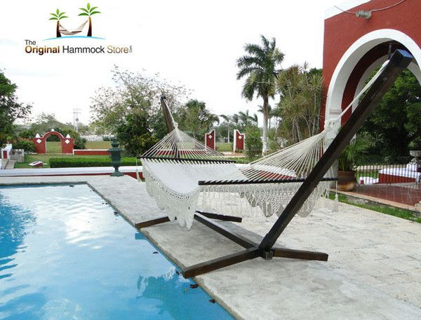 Hammock Stand: This original and contemporary designed stand offers the ideal luxury base for our deluxe range of hammocks, the ultimate in outdoor luxury. This sturdy frame has been expertly crafted using wood from a natural pine tree with connecting iron casts and iron hooks for a quick and easy assembling. To shop this product, double click the image.