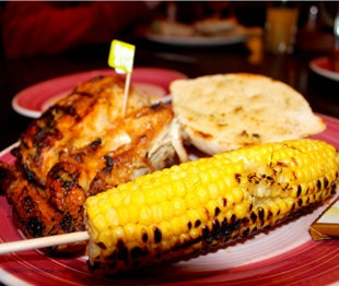 Best Fast Food: South Africa: Nando's  Chicken, basted in one of four consecutively spicier piri-piri chili sauces and flame-grilled to order, is the star at this casual sit-down Portuguese-Mozambique chain. Cheeky advertisements and a welcoming, woodsy aesthetic have propelled Nando's into 30 countries worldwide.    What to Order: 1/2 grilled chicken with hot piri-piri sauce and French fries.