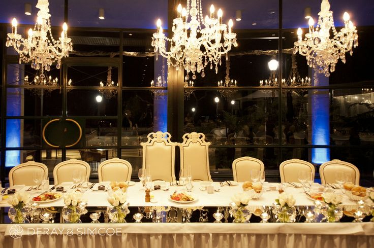 Crystal chandeliers and throne chairs. Wedding reception styling, ideas and inspiration.  Wedding reception at Fraser's Restaurant Kings Park Perth Photography by DeRay & Simcoe