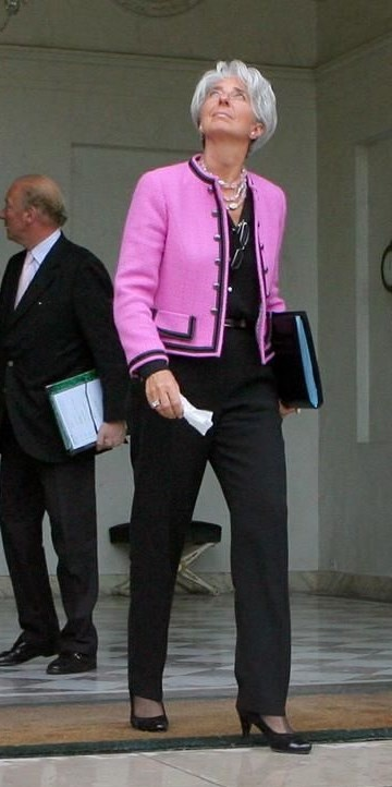 Add a statement jacket. If money is no object Chanel is the way to go. Christine Lagarde runs IMF wearing her trusted sartorial armour, here in pink. Visit my website for finding your own savvy business style: www.ionimage.nl or find me on Facebook: https://www.facebook.com/IonImage