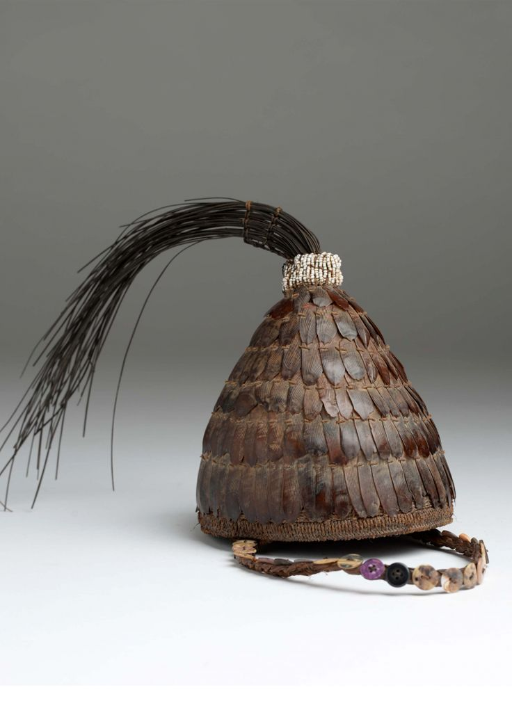 Africa | Hat / headgear from the Lega people of DR Congo | Vegetal fiber, shells, buttons, pangolin skin, elephant hair | ca. 1947 or earlier