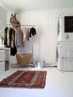 clothes rack in laundry room, weird persian rug, stackable W/D