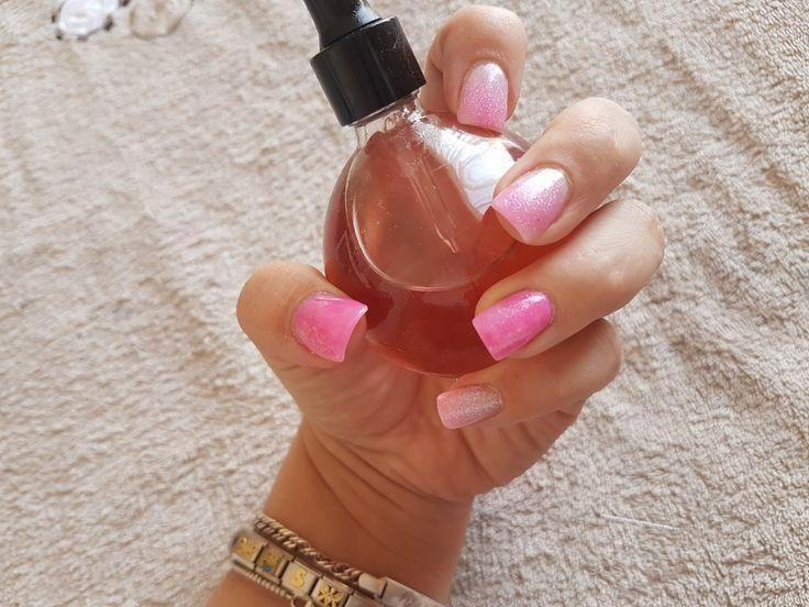 Pink acrylic glitter nails