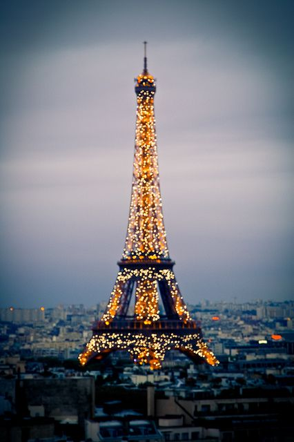{ travel :: the eiffel tower all lit up, paris, france }
