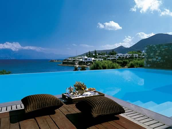 Elounda Bay Palace, Elounda #Greece #Crete The contemporary and stylish Elounda Bay Palace lies on the beach amidst 20 acres of bougainvillaea-filled, jasmine-scented gardens. A member of 'The Leading Hotels of the World', this hotel enjoys panoramic views over the island, where secluded sandy beaches contrast with the beautiful clear waters of the Aegean Sea.  http://www.sovereign.com/hotelDetails.vm?code=HOT0005786&packageID=36&trackLink=1