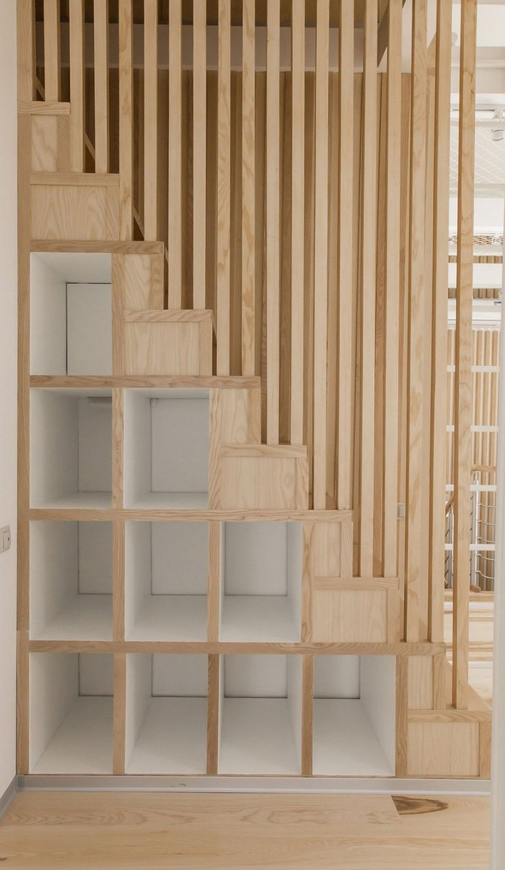 Small wooden shelves give additional display space to the small attic apartment