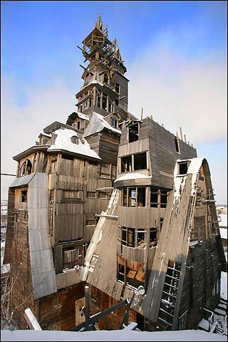 Located in Arkhangelsk, Russia, it is believed to be the world's tallest wooden house, soaring 13 floors to reach 144ft – about half the size of the tower of Big Ben…. and built by a ganster...