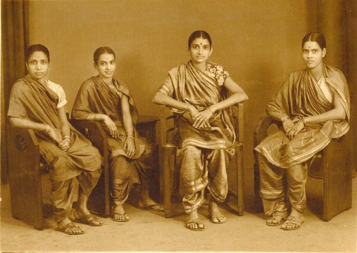 A family portrait, c.1940. I can't get over how casually and gracefully these women have worn their 9 yard Kanjivaram sarees and matched it with puff sleeved printed cotton blouses.