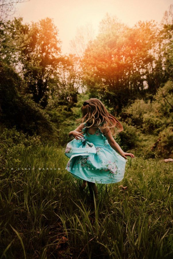 Summer photography -- girl dancing in the sun