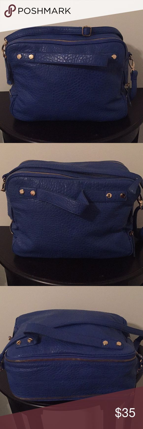 Street Level Large Crossbody Beautiful large blue bag that holds the kitchen sink! You can carry top handle or Crossbody. This bag was used 1 time. No flaws at all! This is just a cool looking bag!! I ship the same or next business day! Street Level Bags Crossbody Bags