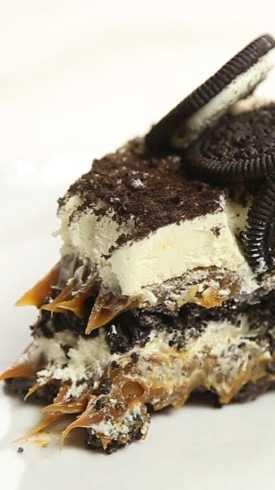 Recipe with video instructions: There's no better way to overindulge your sweet tooth than with Oreos and dulce de leche. Ingredients: 3 Oreo sleeves, 1/4 cup butter, melted, 2 cups dulce de leche, 2 cups whipped cream, To decorate:, 1/3 cup chocolate shavings, 1 Oreo sleeve
