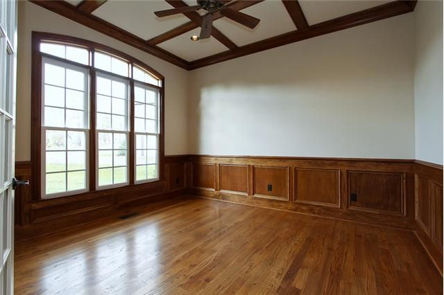 Stained wainscoting in dining rooms door entry from for Wainscoting designs dining room