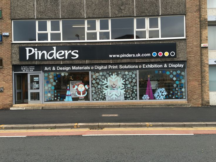 Full window display all printed in house window vinyls modern christmas tree stand ups with snowflakes Father Christmas and reindeers. Contact sales@thinkpinders.com for more details