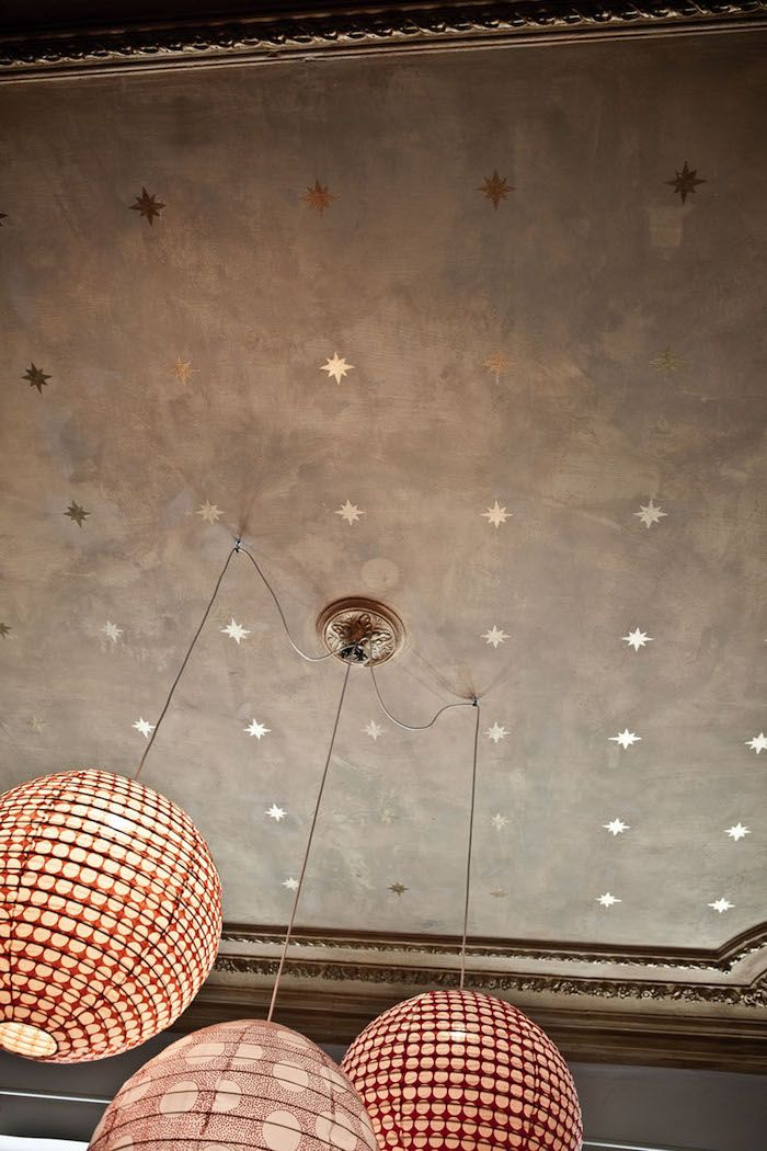 "designmeetstyle: "" dustjacketattic: "" gold star ceiling and paper lanterns 