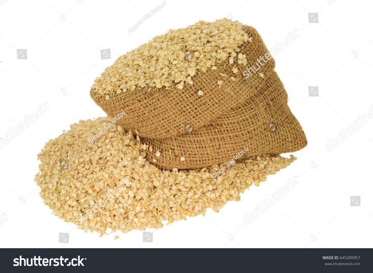Processed to Flakes Organic Quinoa seeds in burlap bag and spilled out on pile isolated over white background