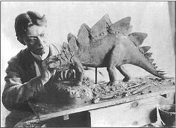 The World of Charles R. Knight working on a stegosaurus.
