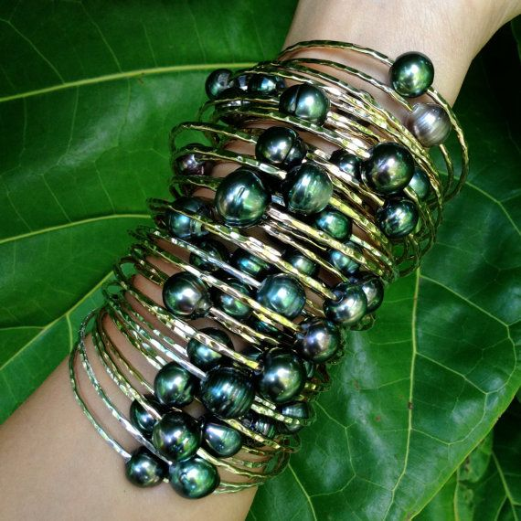 Hey, I found this really awesome Etsy listing at http://www.etsy.com/listing/118978599/special-tahitian-pearl-bangle-14kt-gold