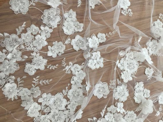 £39.40 Gorgeous new arrival beaded ivory bridal lace fabric, with handmade applique flowers, special style for a famous fashion brand Fabric width is about 130 cm , price is for one yard, if you buy more, it will be cut as one piece .  chic and fresh bridal lace fabric, perfect for wedding gown, bridal dress, costume design .   my shop link:  http://www.etsy.com/shop/lacetime    Thank for shopping and have a nice day forever…