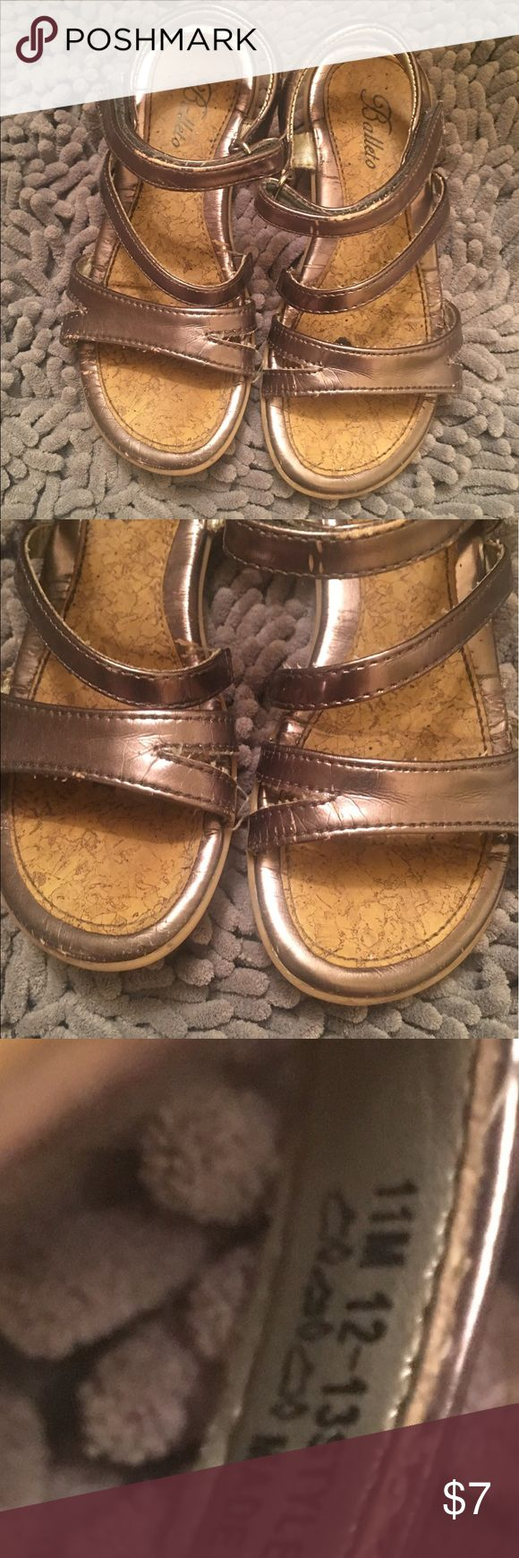Girls size 11 silver sandals Quality made sandals. They have some use but in good condition. The only noticeable wear is by the ankle bone strap where the foiling has worn off and minimal wearing on toes as shown in pictures and only noticeable close up. Balleto Shoes Sandals & Flip Flops