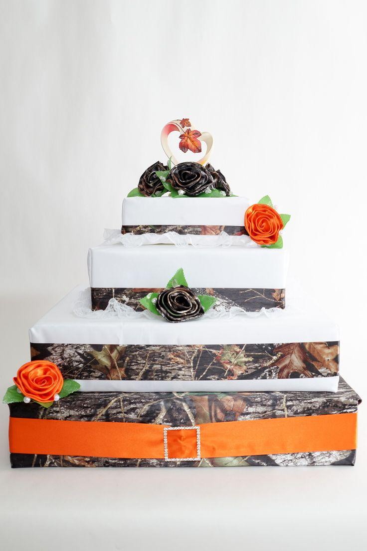 Cake Base Shown In Mossy Oak With Orange Ribbon Camo Wedding